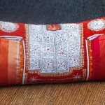 Orange Pakistani Tribal Kurta on Handwoven Sabra Silk Sofa Cushion